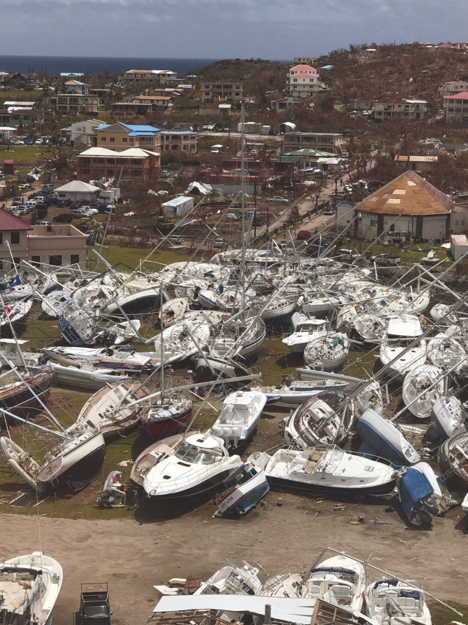 This Sept. 14, 2017 photo provided by Guillermo Houwer on Saturday, Sept. 16, shows some damaged boats at the Virgin Gorda Yacht Harbour in the aftermath of Hurricane Irma on Virgin Gorda, in the British Virgin Islands. (Guillermo Houwer via AP) ORG XMIT: UGC143